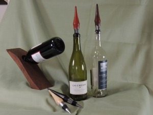 Wine bottle stand and stoppers
